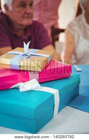 Close-up of three colorful gifts placing on top of each other