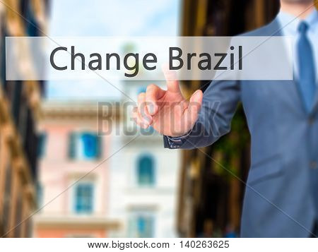 Change Brazil -  Businessman Press On Digital Screen.