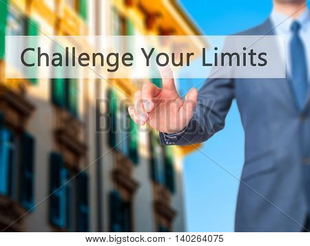 Challenge Your Limits -  Businessman Press On Digital Screen.