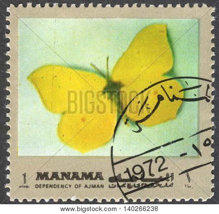 MOSCOW RUSSIA - CIRCA FEBRUARY 2016: a post stamp printed in Ajman shows a butterfly Gonepteryx rhamni the series