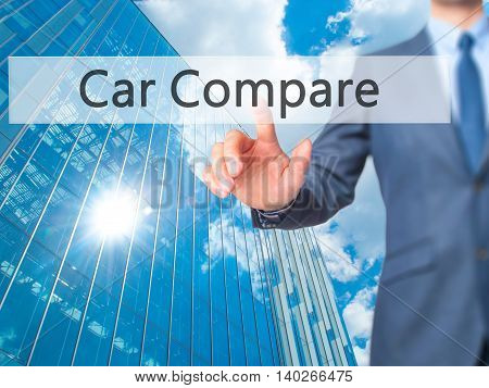 Car Compare -  Businessman Press On Digital Screen.
