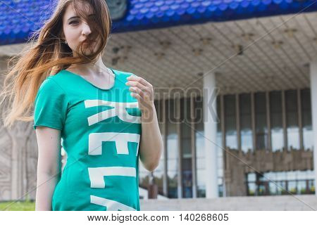 Young female coucasian model in casual style at the city street