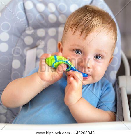 Cute baby boy brushing teeth