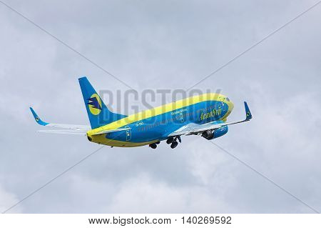Borispol Ukraine - October 2 2011: AeroSvit Boeing 737 is taking off into cloudy sky