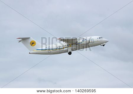 Borispol Ukraine - October 2 2011: Antonov An-148 regional passenger plane is taking off into cloudy sky and retracting its gear