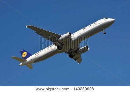 Borispol Ukraine - June 9 2011: Lufthansa Airbus A321 is landing with blue sky on the background
