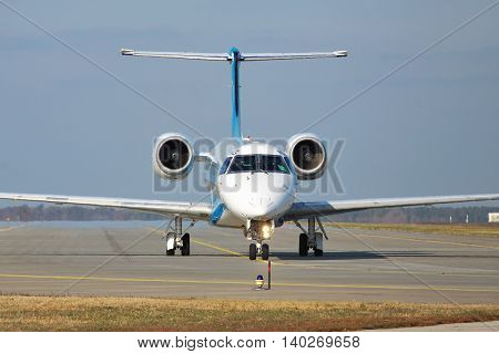 Borispol Ukraine - October 23 2011: Dniproavia Embraer ERJ-145 regional passenger plane is taxiing to the runway for takeoff