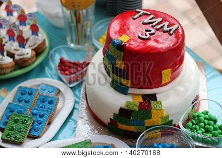 Colorful cake like toy with many different candies for 3 years old boy