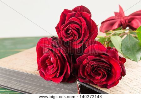 Red Roses On A Open Book