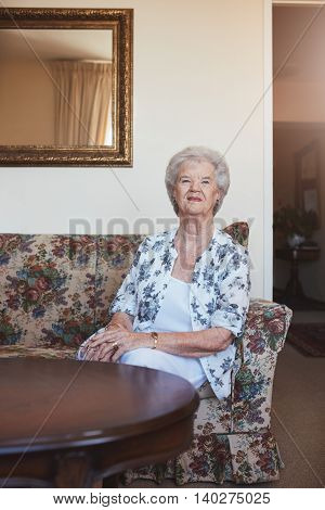 Elderly Woman Sitting On A Couch At Old Age Home