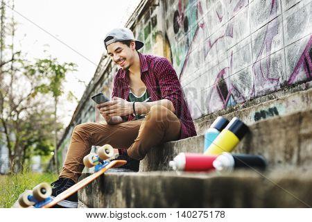 Teenager Boy Texting Skateboard Concept