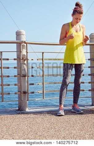 Young Woman In Fitness Outfit At Embankment