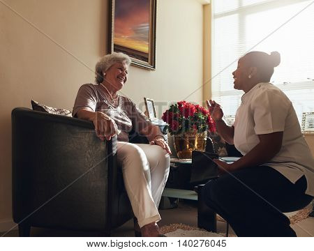 Nurse Visiting Senior Patient Home For Routine Checkup