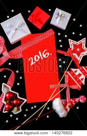 Winter frame: christmas decoration surrounding red envelope on black background
