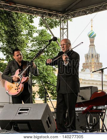 St. Petersburg, Russia - 23 July, Musicians play jazz in the open air, 23 July, 2016. Speech by David Goloschekin with his jazz group on the Arts Square in St. Petersburg.