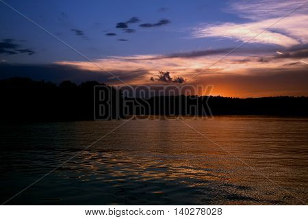 Dramatic sunset over the lake with red clouds