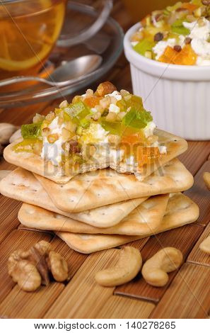 portion of cottage cheese with jam and marmalade nuts on a cracker