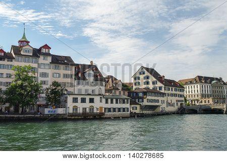 Zurich, Switzerland- august 22, 2010: Traditional houses on embankment Limmat river in historic Zurich city center Canton of Zurich Switzerland