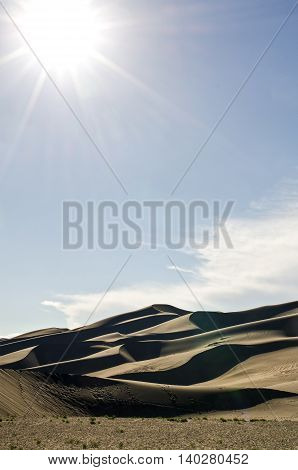 Sand dunes outside of Alamosa Colorado with sunbeam