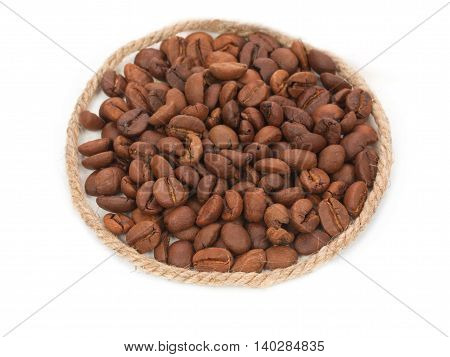 Roasted coffee beans pile from top with decorative rope twine isolated on white background.