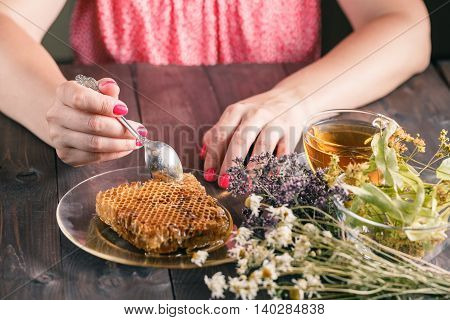 Natural medicine herbs, tea and honey on table