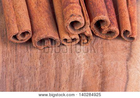 Cinnamon sticks on a wooden background, close-up