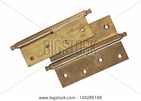Pair of old brass hinges isolated on a white