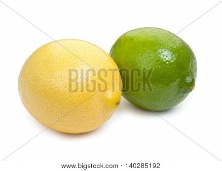 Lime and lemon isolated on white background, close-up.