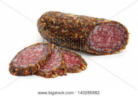 Sliced salami with spices isolated on white background