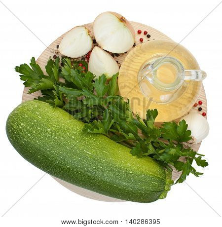 Green Zucchini, Garlic, A Bottle Of Vegetable Oil, Parsley, Onion, Mixed Peppercorns Against The Bac