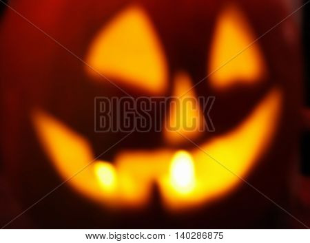 defocused Halloween jack o lantern with glowing candles background toned with a retro vintage instagram filter app or action