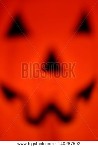 defocused close up of a plastic Halloween jack o lantern decoration