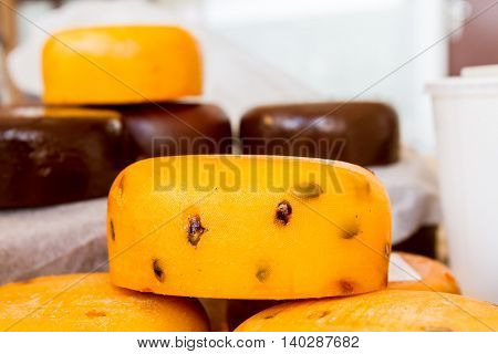 Various types of cheese for sale on food market