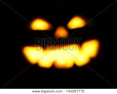 defocused and blurred Halloween jack o lantern background glowing in the evening toned with a retro vintage instagram filter app or action