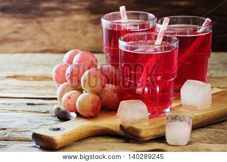 Fresh grape juice with ice and fresh fruit. Healthy and diet food. Selective focus