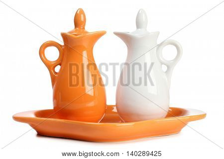 Porcelain jar and a salt shaker on white background