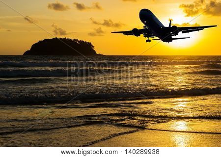 Beach with plane on color of the sunset in twilight over light the sun