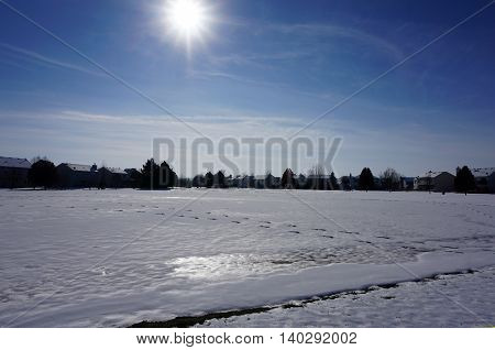 The sun shines over a residential area of Joliet, Illinois, after a November snow storm.