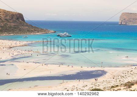 Breathtaking panorama of Balos beach and lagoon and Gramvousa island on Crete, Greece. Tourist boats mooring in lagoon.