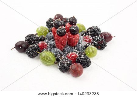 lot of different berries in the shape of a square on a white background