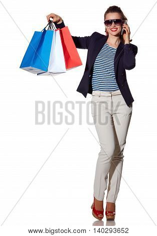 Woman Talking On A Smartphone And Showing Shopping Bags