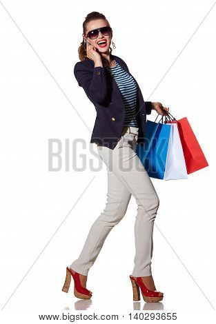 Woman With Shopping Bags Woman Talking On Smartphone And Walking