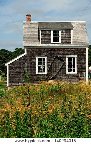 Brewster Massachusetts- July 14 2015: 1867 Henry Hopkins Blacksmith Shop at the 18th century Higgins Farm Windmill historic site on Cape Cod