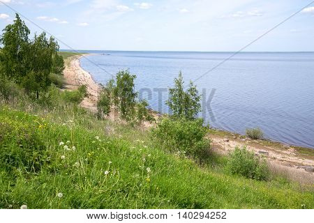 Beach of the lake Ilmen, sunny june day. Landmarks of the Korostyn village, Novgorod region, Russia