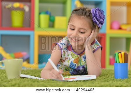 Portrait of Little girl drawing at class