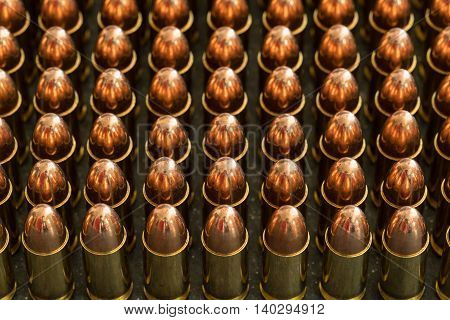 9 mm ammunition bullets on the dark background slate