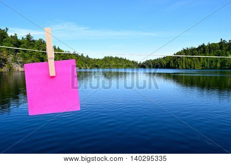 blank sticky note with copy space with a lake background