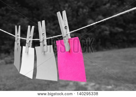 creative art concept. isolated pink sticky note on black and white background.