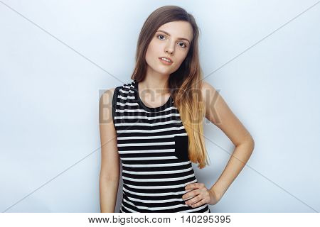 Portrait Of Happy Young Beautiful Woman In Striped Shirt Posing Hands On Hip For Model Tests Against