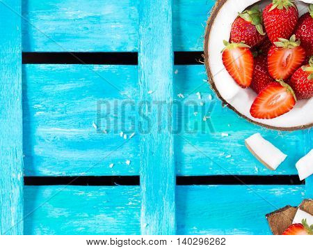 Coconut And Strawberries On Summer Blue Background